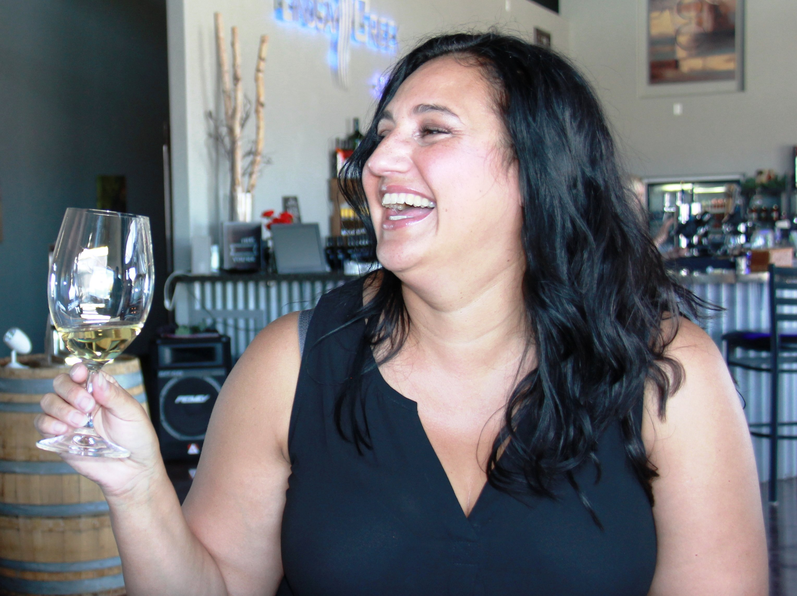 A guest having a good time with Twisted Vine Wine Tours, llc
